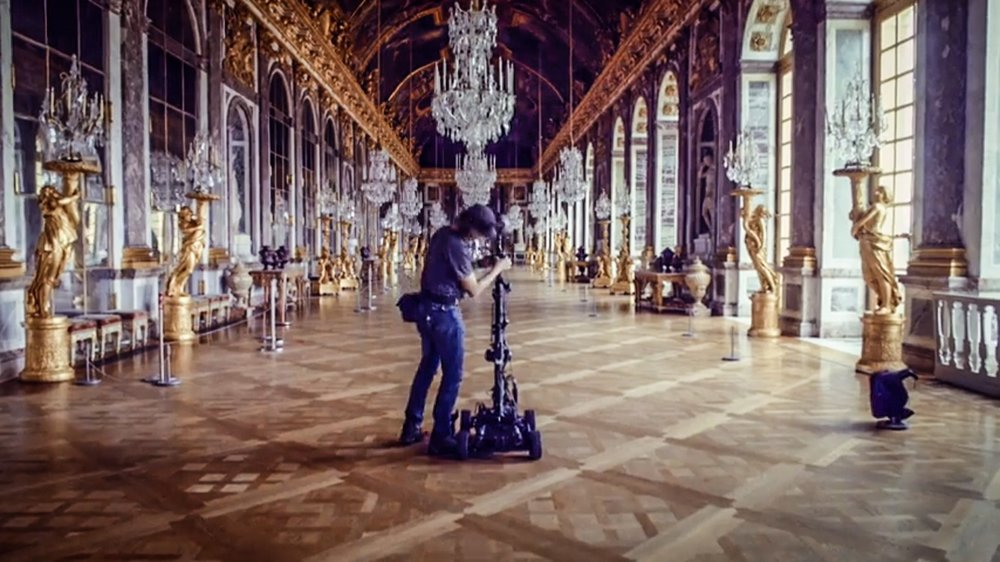 Sébastien, getting ready to drive a Nokia Ozo on a Mantis 360 remote control car, inside the Hall of Mirrors, in the Castle of Versailles, in France.