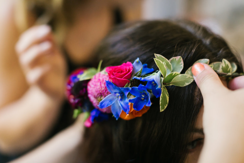 Bride's floral crown as it's being put on