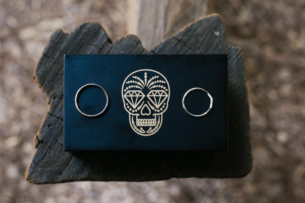 Rings on diamond skull box on wood