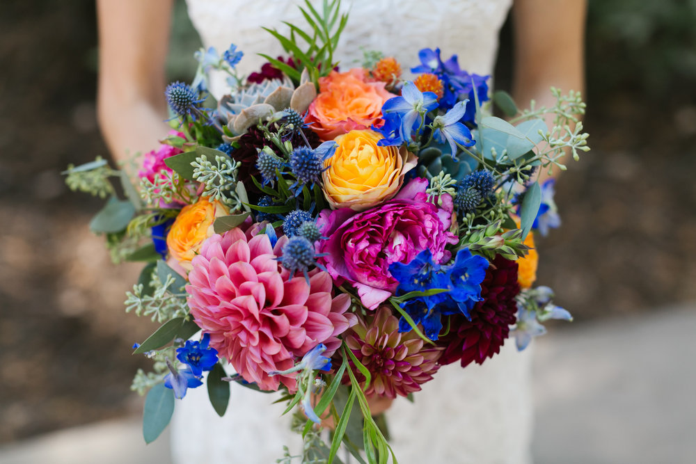 Colorful wedding bouquet with pink dahlias