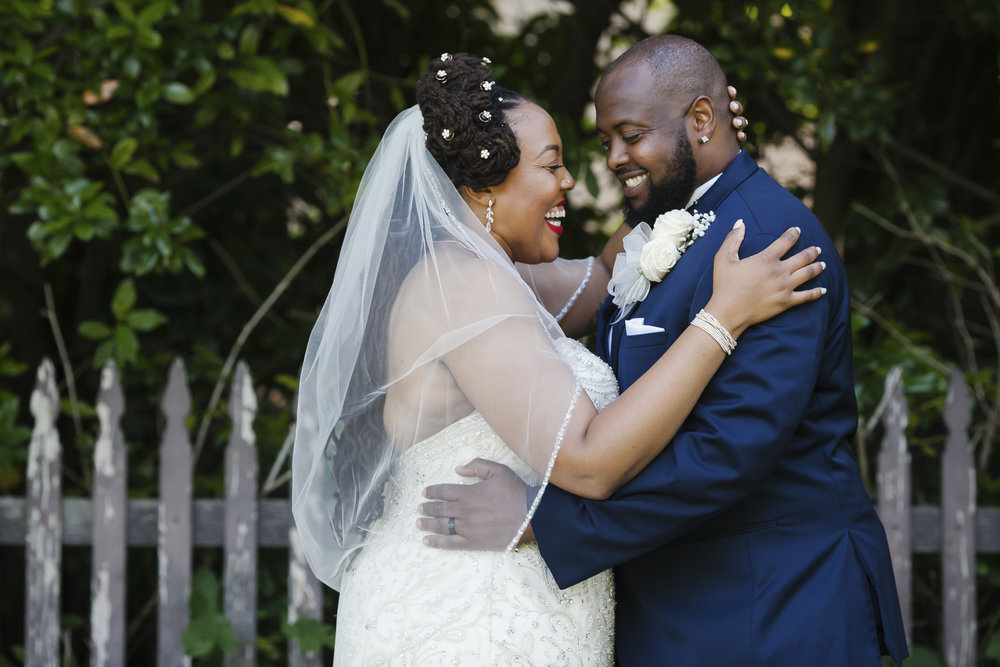 A couple laugh together on their wedding day