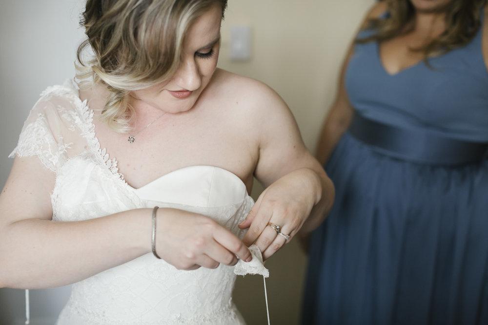 A bride gets into her wedding dress