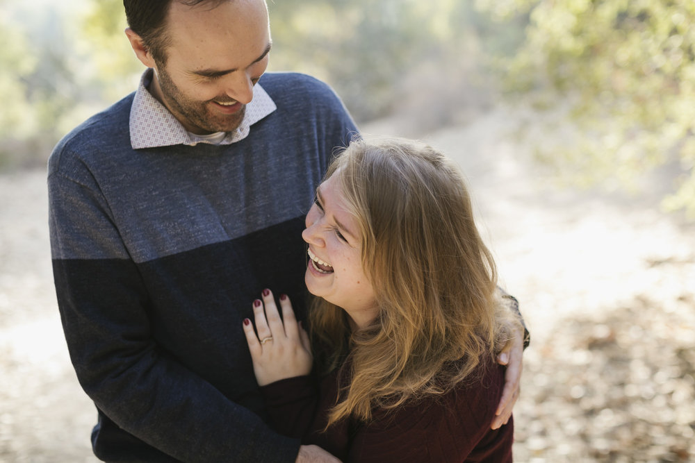 Engaged couple laugh hysterically at Arroyo Seco in Pasadena