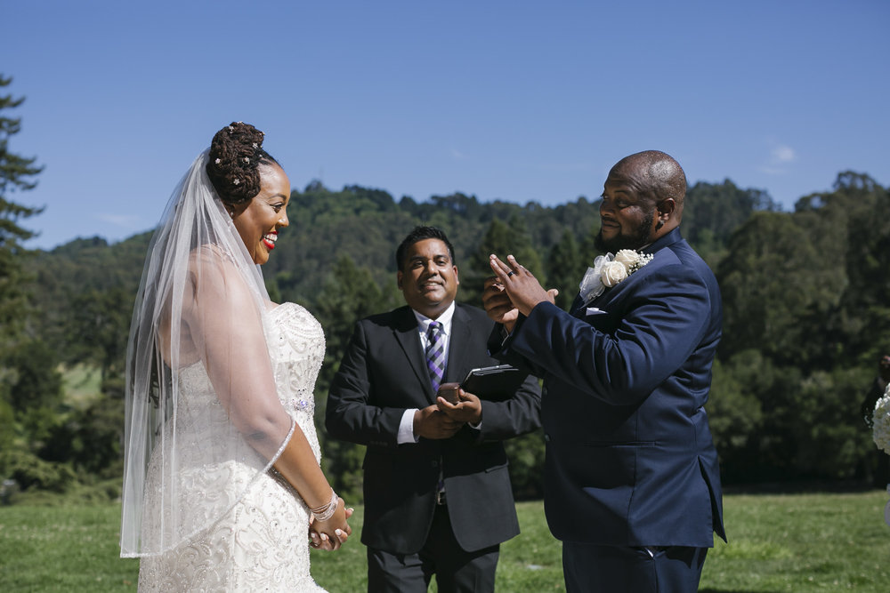 Groom admires his wedding ring at outdoor ceremony in Tilden Park