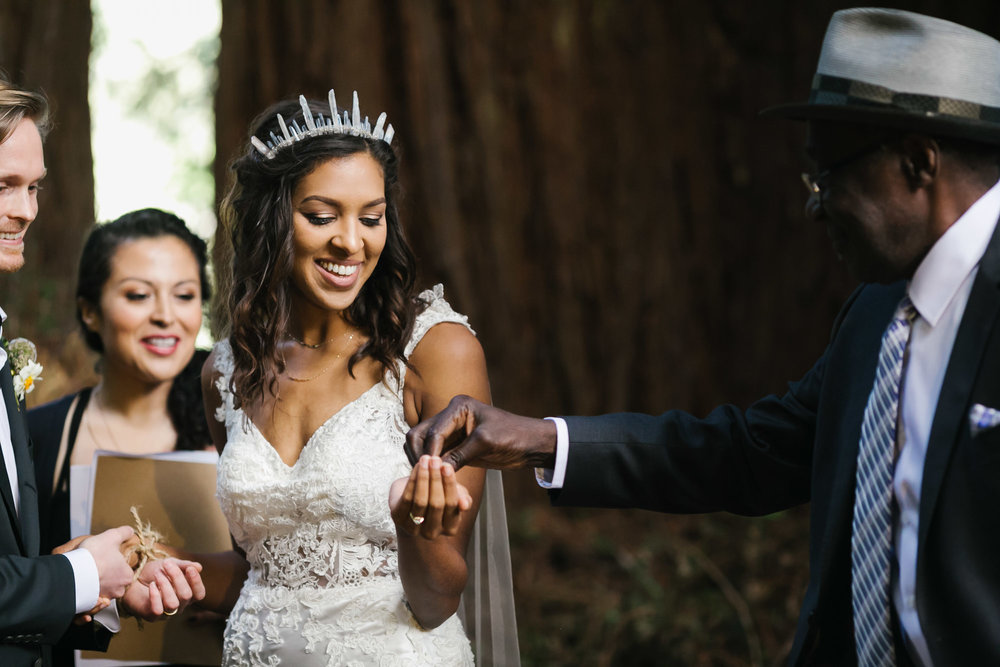 Bride accepts coins from her father during wedding ceremony