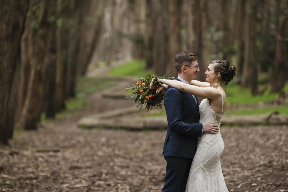 Bride and groom hug at the Wood Line in San Francisco
