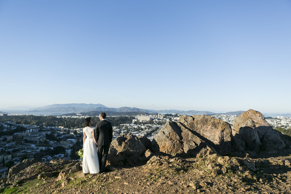 Wedding couple look out at the San Francisco view