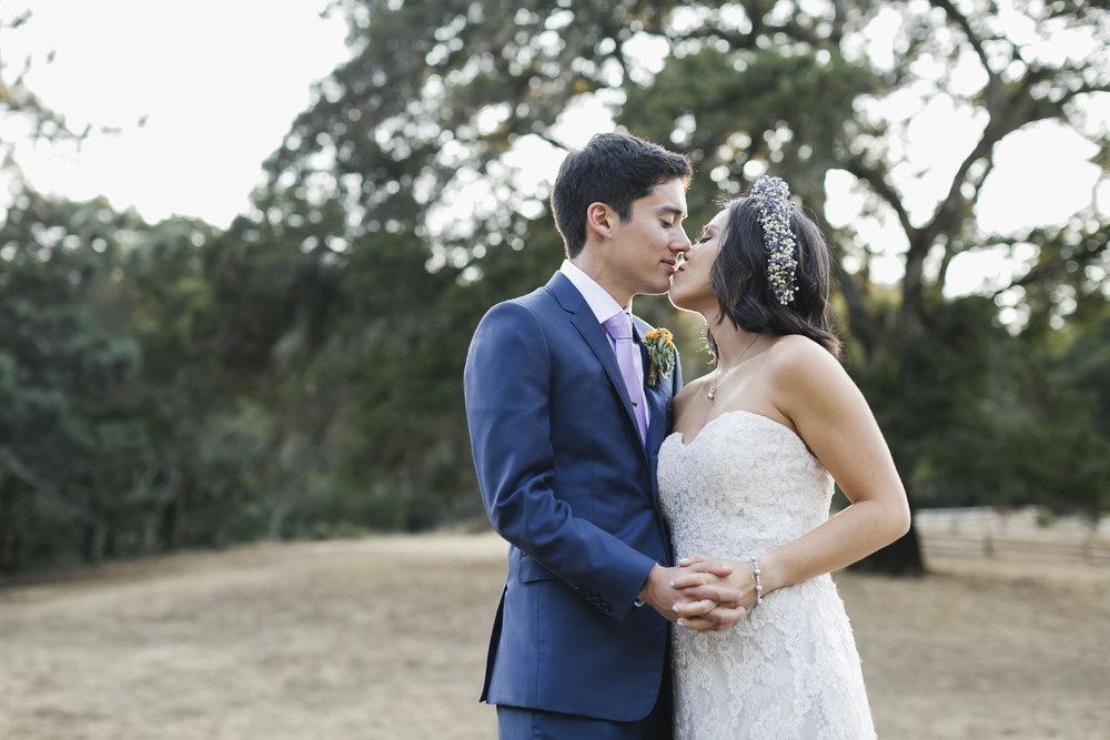 Wedding couple kiss during their picnic redwood wedding