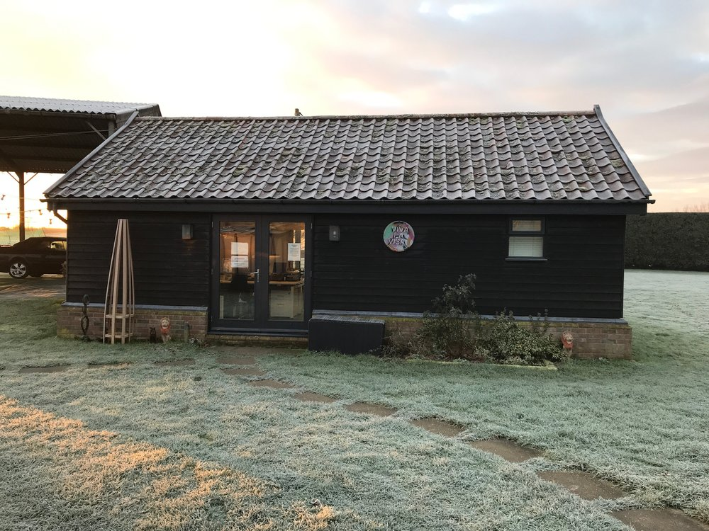 Our office is lovely! - It's so bright with lots of windows, and as we are based in beautiful Suffolk surroundings, it's so peaceful. We have spacious desks with a kitchenette, and lots of cupboards in which to store chocolate biscuits.This is what our office looks like on a Winter morning.