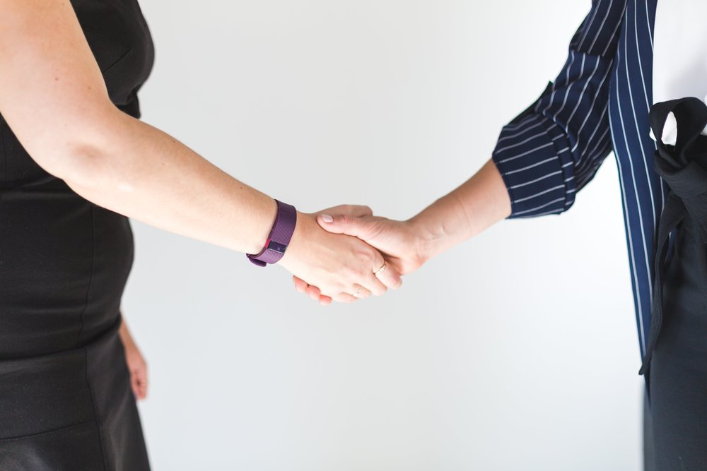 business-women-shaking-hands_4460x4460.jpg