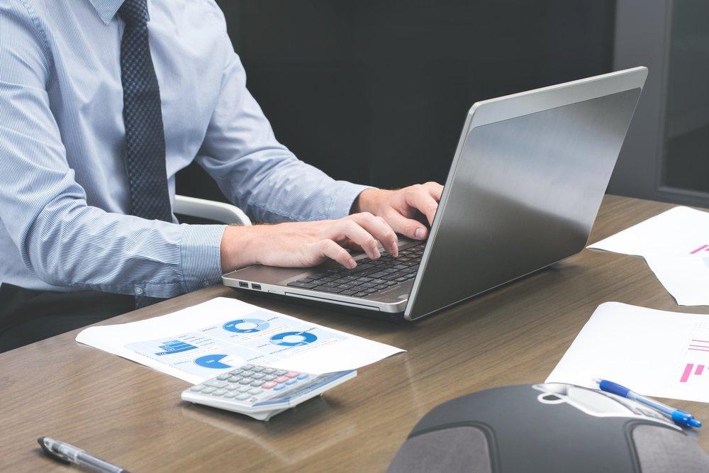 office-staff-typing-on-laptop_4460x4460.jpg