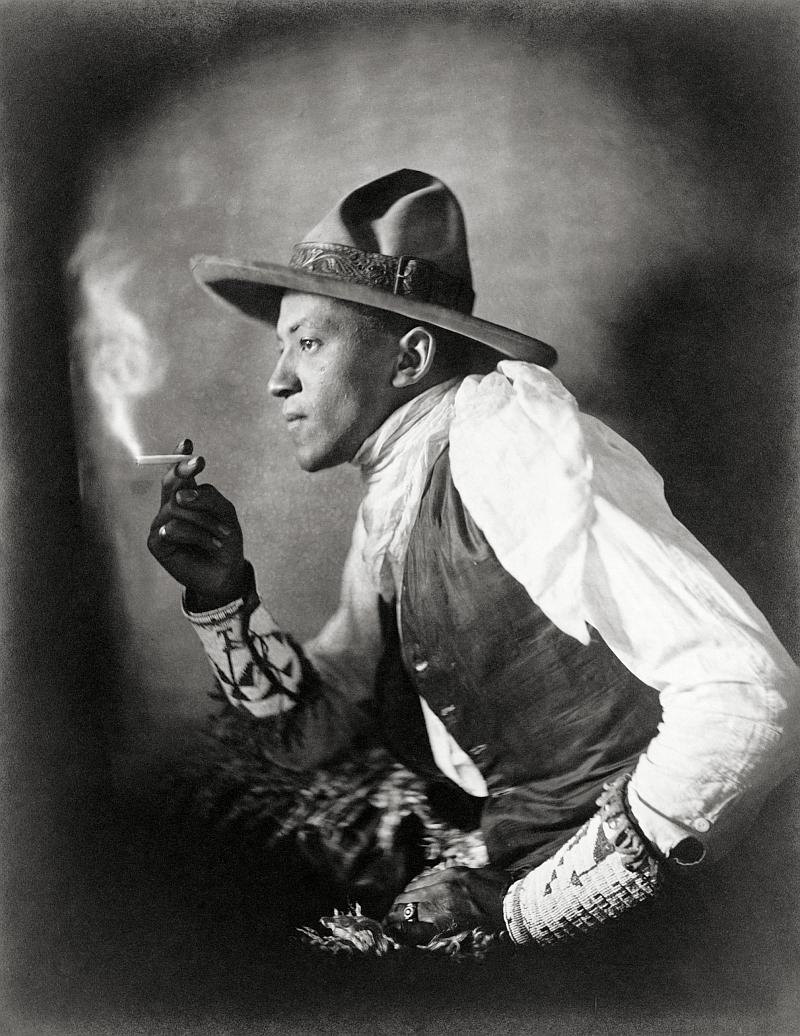 Sioux man smoking a cigarette (1908).jpg