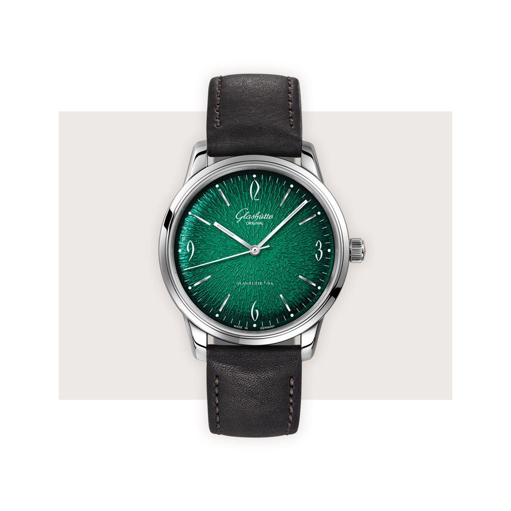 Glashütte Original - As if the textured emerald face of this watch is not stunning enough, the sapphire caseback allows you to admire the skeletonized rotor with oscillating mass in 21-carat gold.Glashütte Original Sixties, $7,500; troverie.com