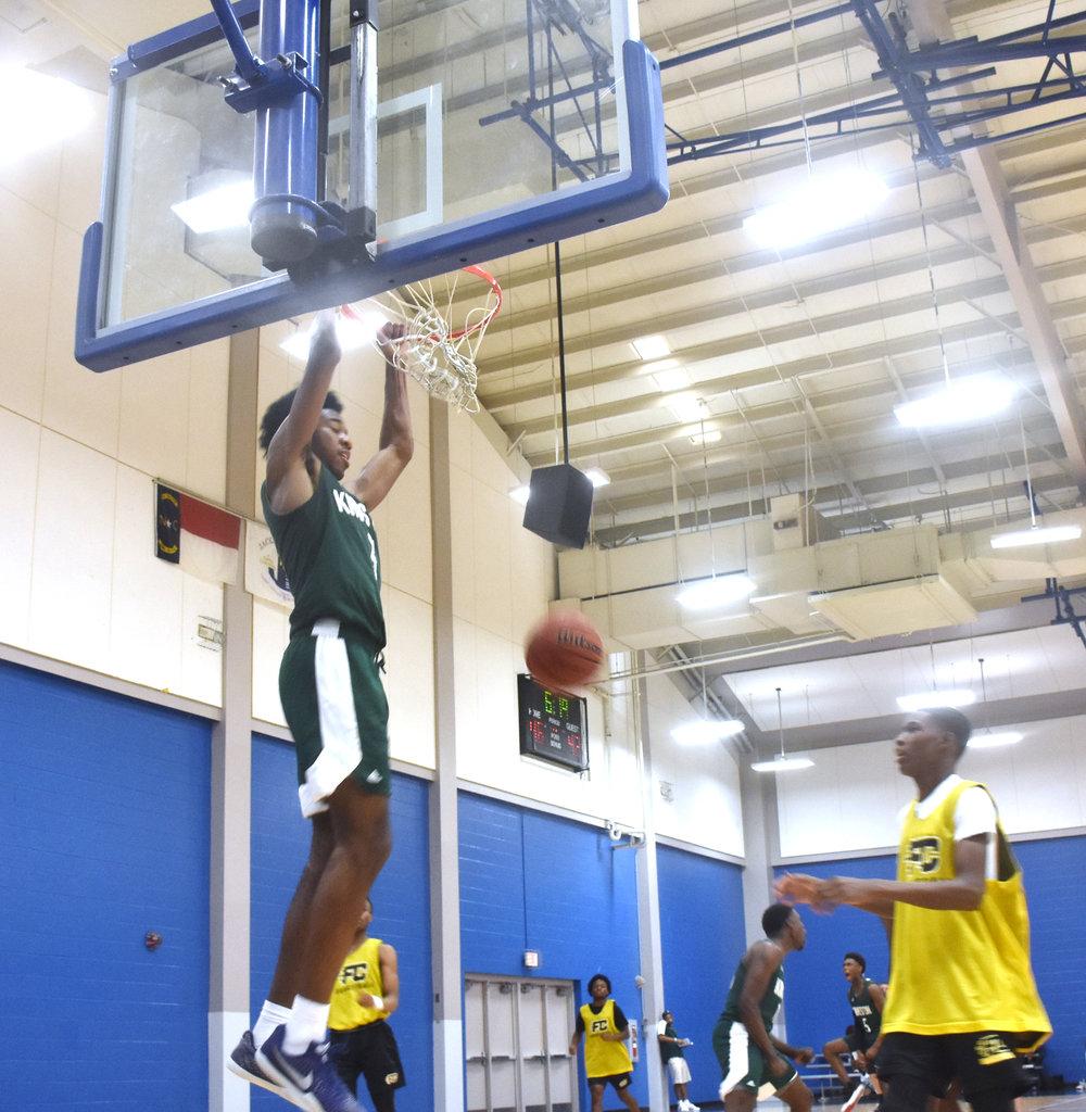 Kinston sophomore Dontrez Styles dunks during Saturday's East Coast Invitational in Jacksonville. Photo by Bryan Hanks / Neuse News