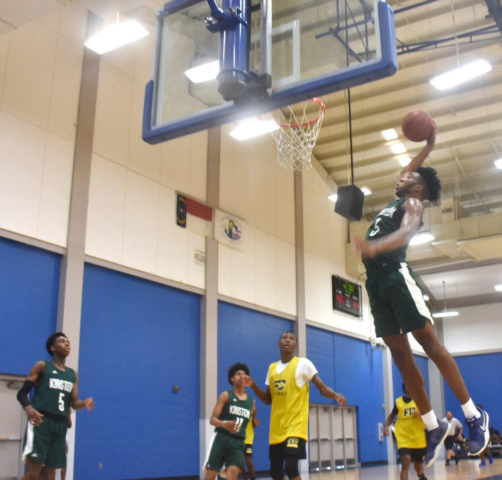 Kinston's Dontrez Styles flies in for a dunk. Photo by Bryan Hanks / Neuse News