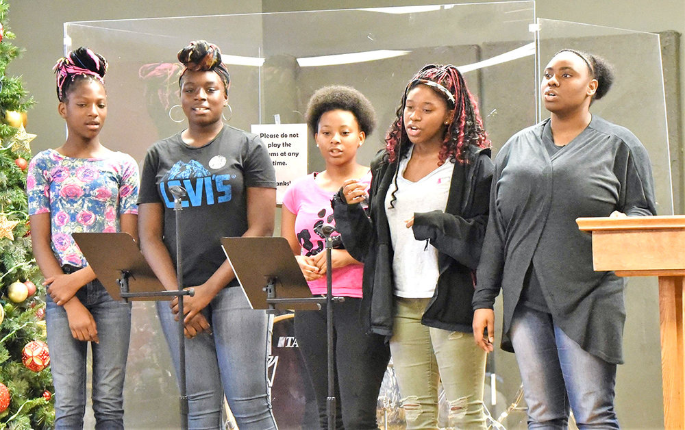 God's Gift -- an a capella group from The Gate -- sings at Saturday's ceremony. Photo by William 'Bud' Hardy / Neuse News