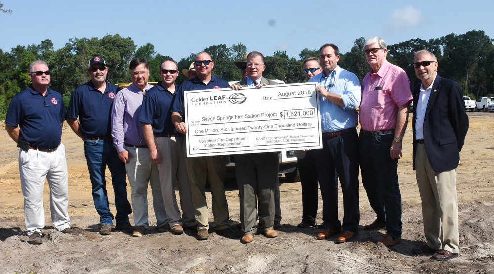 Officials hold the oversized check presented by Golden Leaf President Dan Gerlach. Photo by Linda Whittington / Neuse News