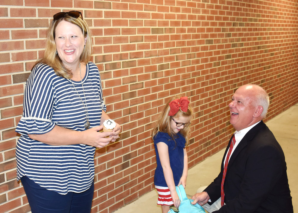 Natalie Sweeley, left, and Bright share a laugh with Sweeley's daughter Anna Kate, a kindergarten student, on Monday. Photo by Bryan Hanks / Neuse News