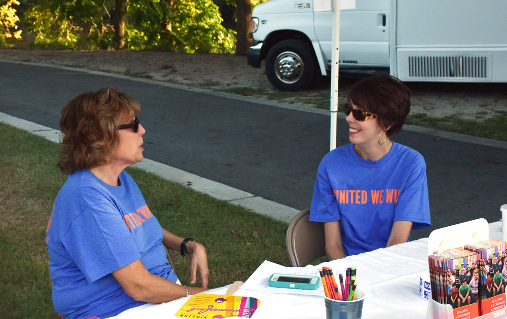 Lenoir-Greene United Way Executive Director Molly Taylor, right, and United Way board member Barbara LaRoque chat during the concert.