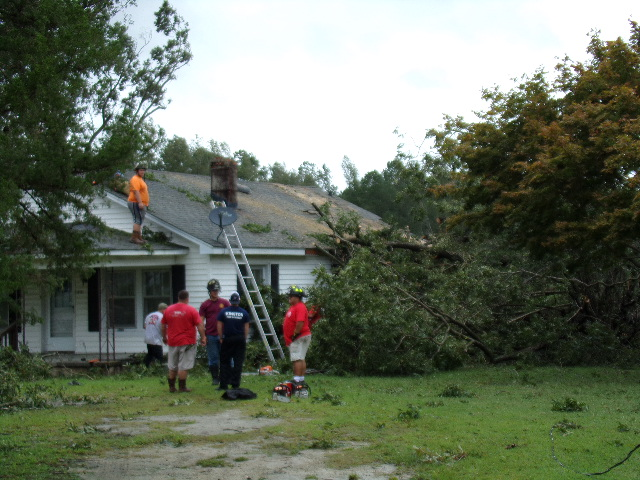Hugo and Kinston crews work togther to remove downed tree