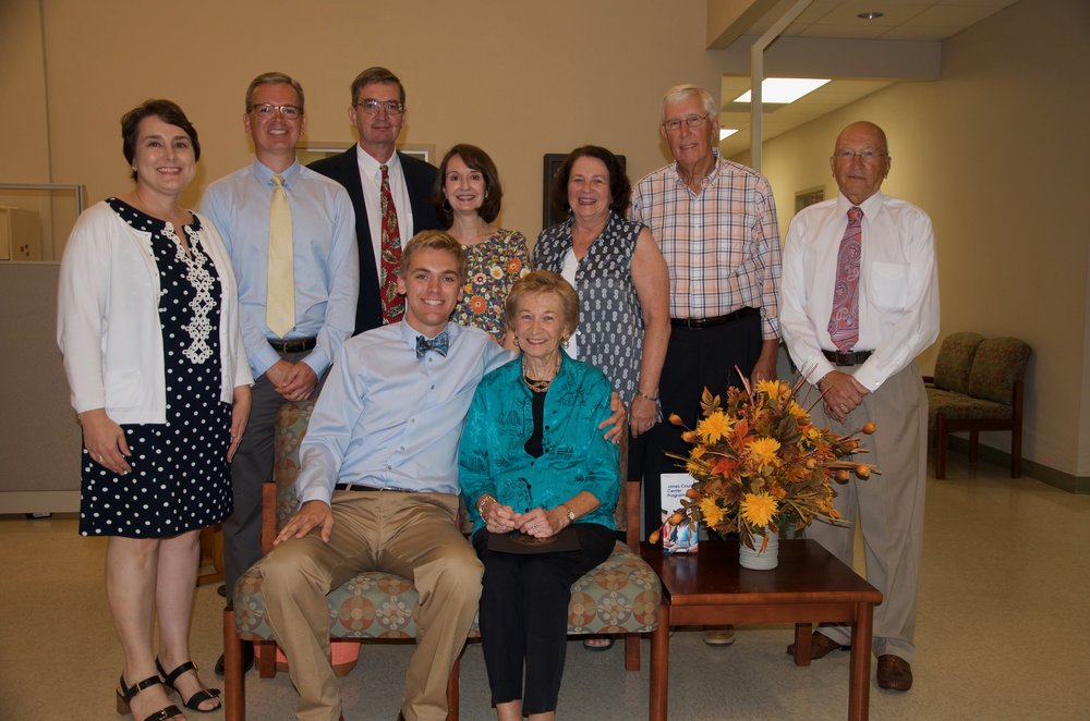 Pictured left to right: Adam Hood, grandson, and Carol Hood, Order of the Long Leaf Pine recipient; standing, Beth and Paul Hood, daughter-in-law and son, Martin and Beth Hood, son and daughter-in-law, Anne and Bobby Gilmore, sister and brother-in-law, and Lawrence Mallard, brother. Photo by Richy Huneycutt / Lenoir Community College