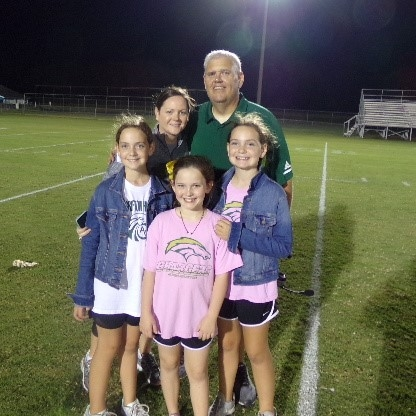 Coach Cornwell, his wife Carrie and their children. Photo by Scott Cole / Neuse News