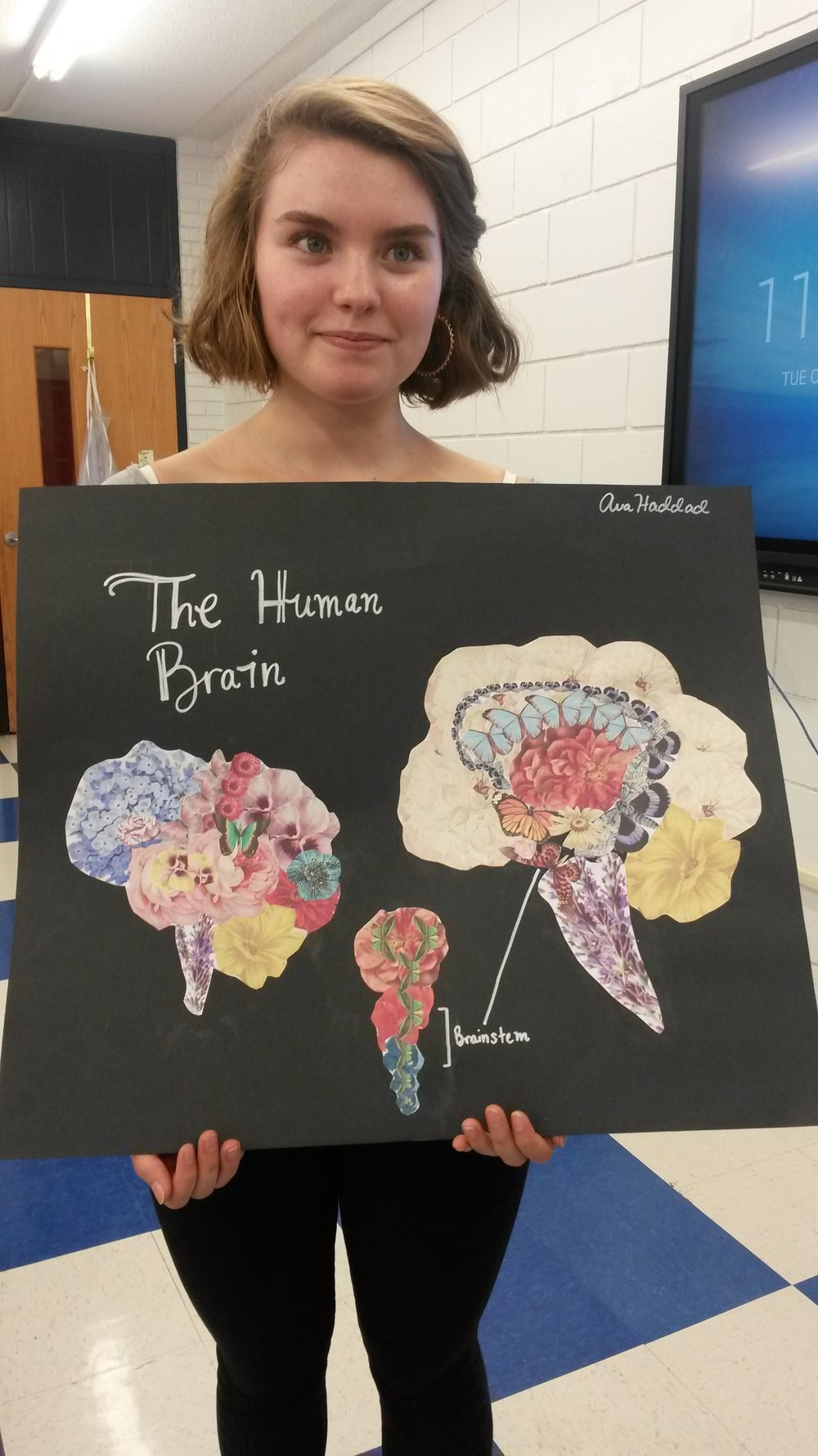APA student Ava Haddad used floral images to illustrate the brain's structure.  Photo by Vicki Kennedy / Arendell Parrott Academy