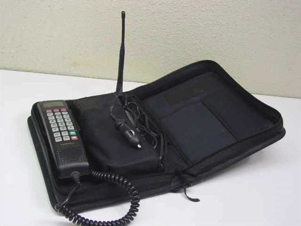 Photo of an early model bag phone.