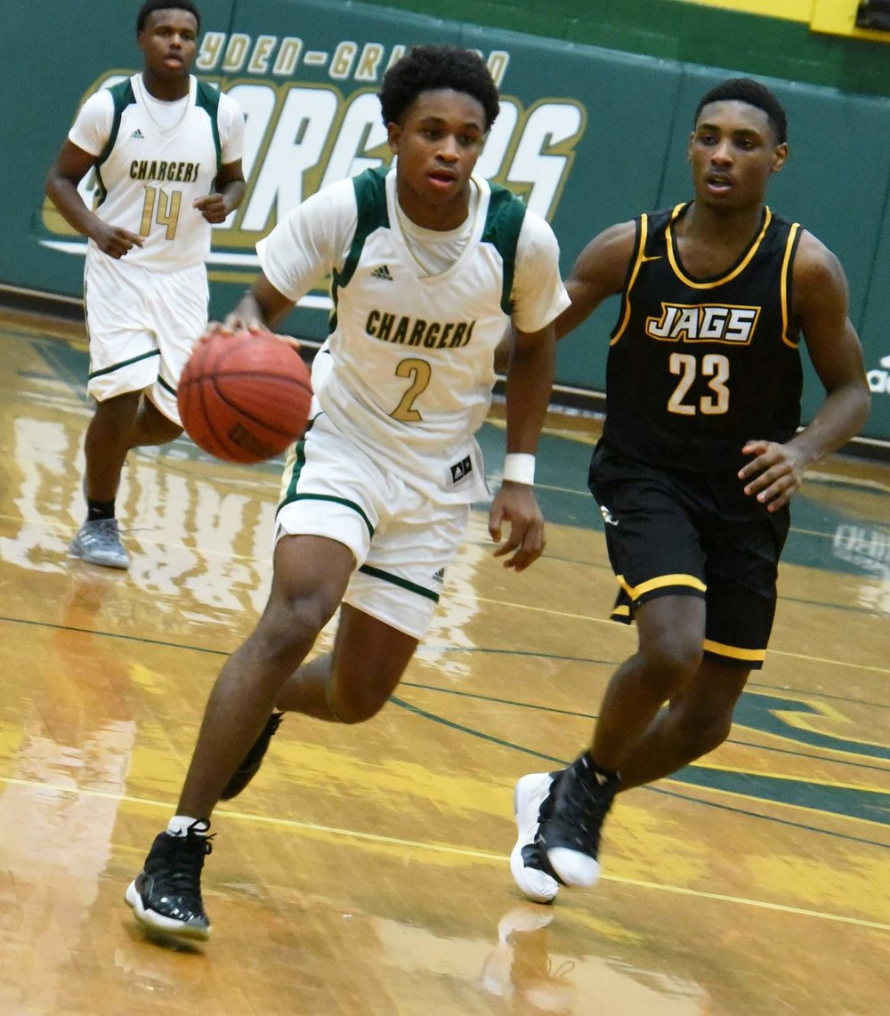 "Ayden-Grifton's James Richardson drives down the court while being pressured by Farmville Central's Samage Teel in Tuesday's contest. Photo by William ""Bud"" Hardy / Neuse News"