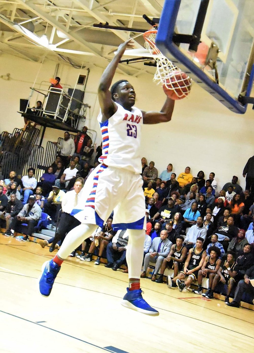"""Greene Central's Imajae Dodd slams home two of his game-high 19 points in Friday's game against Farmville Central. Photo by William """"Bud"""" Hardy / Neuse News"""