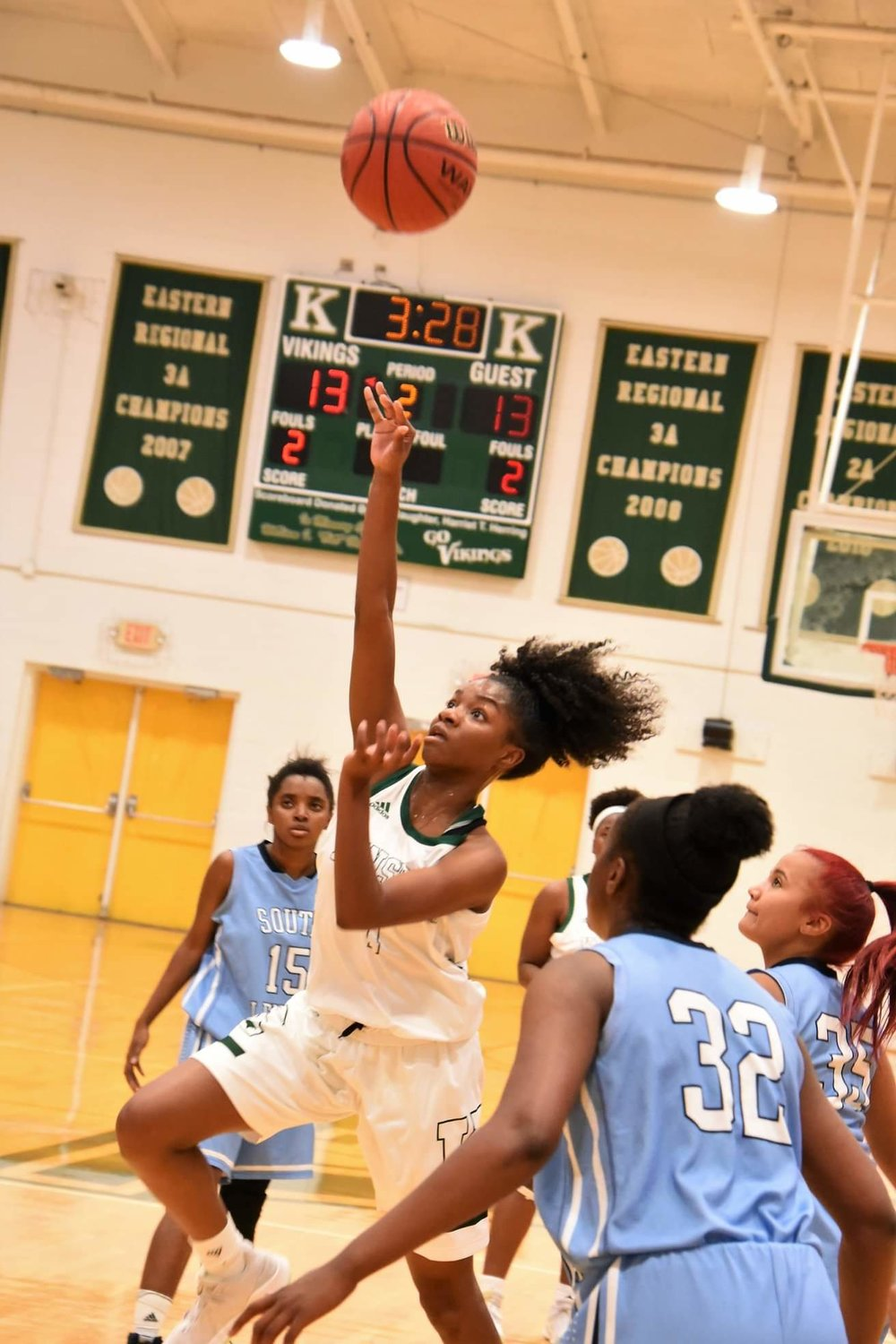 """Kinston's Lesley Sutton throws up a floater through the heart of the South Lenoir defense in Monday's game. Photo by William """"Bud"""" Hardy / Neuse News"""