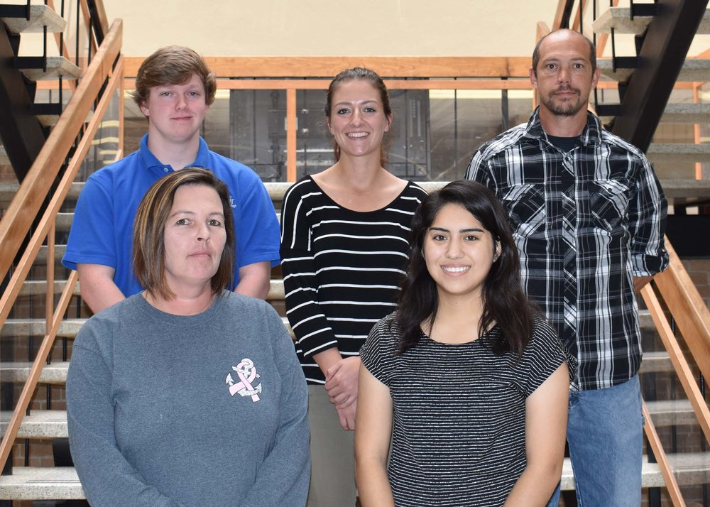 Pictured left to right are Peggy Ferris of Pink Hill, Frances Carr Parker Scholarship; and Cecilia J. Agvilar Escamilla of La Grange, LCC Guarantee Scholarship and the Bojangles/Tands Scholarship; back row, Sethan Moody of Pink Hill, Bradley Blair (Brad) Burmahl Memorial; Meagan Stapleton of New Bern, Fodie H. Hodges Memorial; and Stephen Marshburn of Pink Hill, Richard Floyd (Rick) Lennon Memorial.