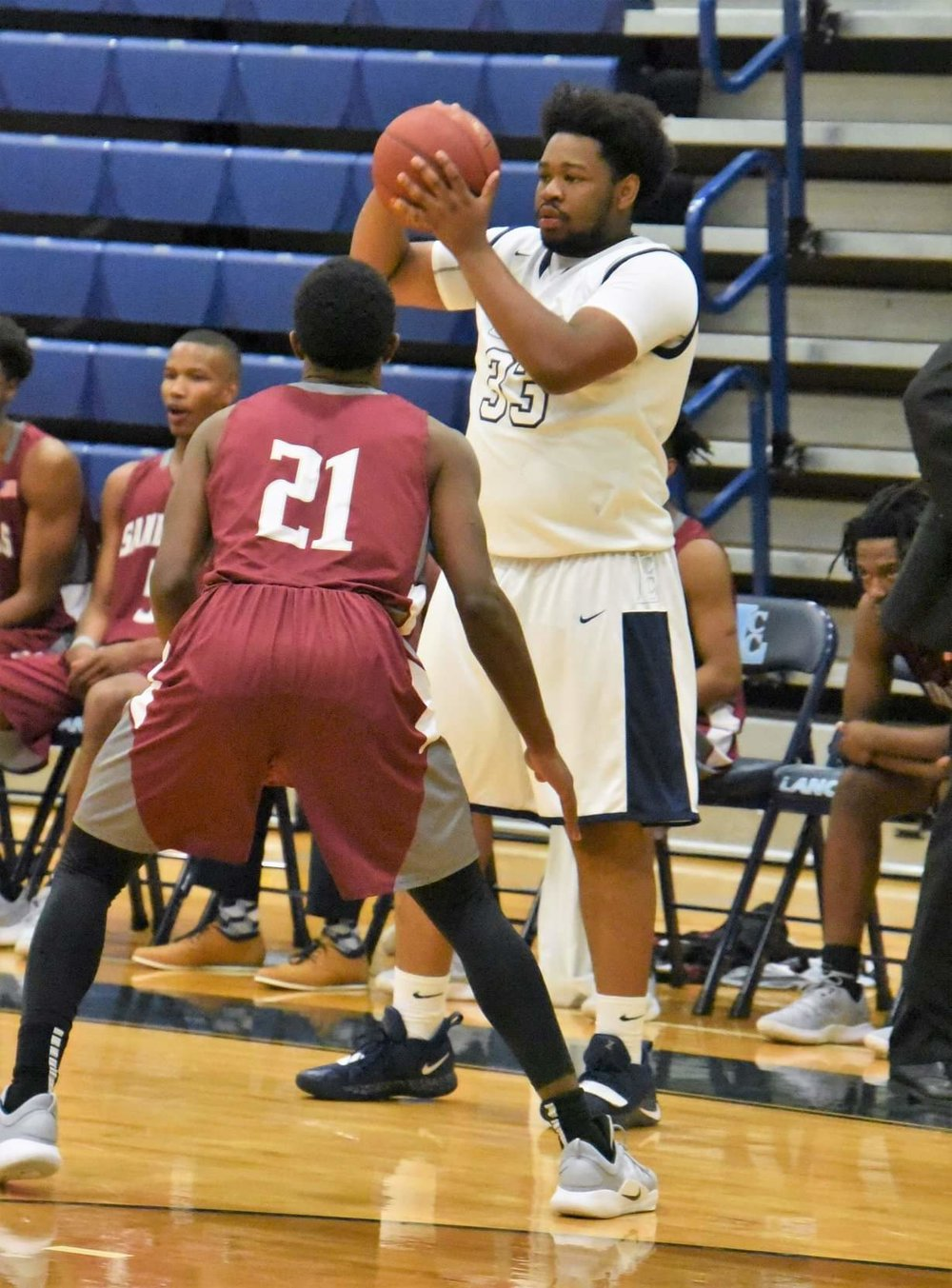 """LCC's Daimian Burnett prepares to make a pass during Wednesday's contest against Sandhills CC. Photo by William """"Bud"""" Hardy / Neuse News"""