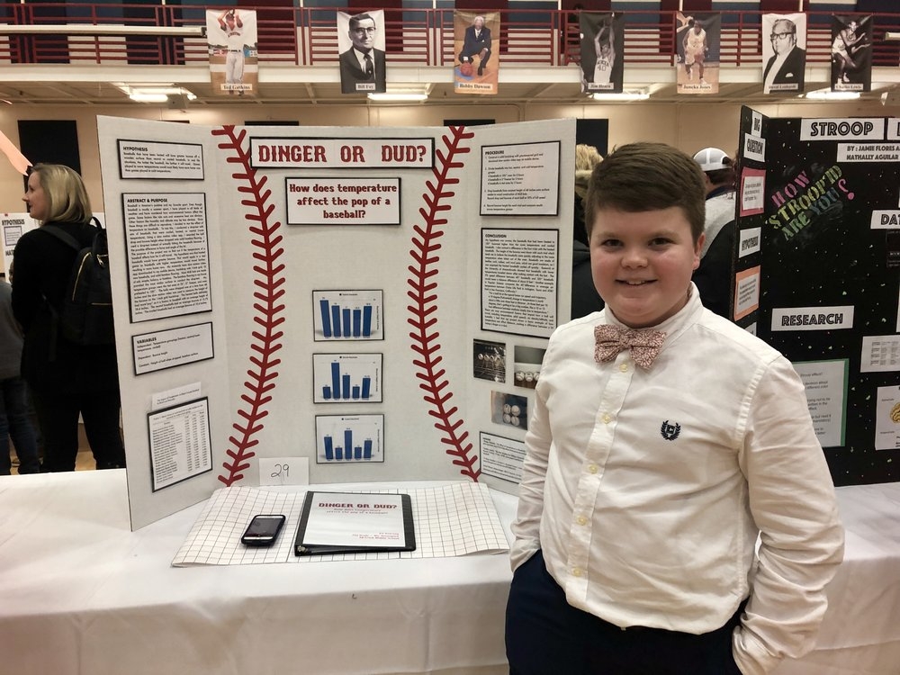 Seventh-grader Eli Kearney studied temperature impacts on baseballs. Photo by Catherine Hardee/Neuse News