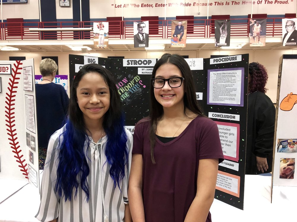 Contentnea-Savannah seventh graders Nathally Aguiar and Jamie Flores with their project on the Stroop Effect. Photo by Catherine Hardee/Neuse News