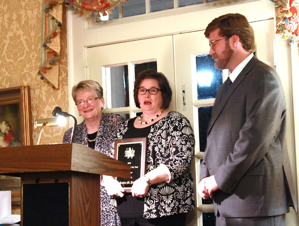 Robin Jones, center, was named the Ambassador of the Year by the Chamber. She was announced by Jess Edwards, right, and Judy Jones. Photo by Linda Whittington / Neuse