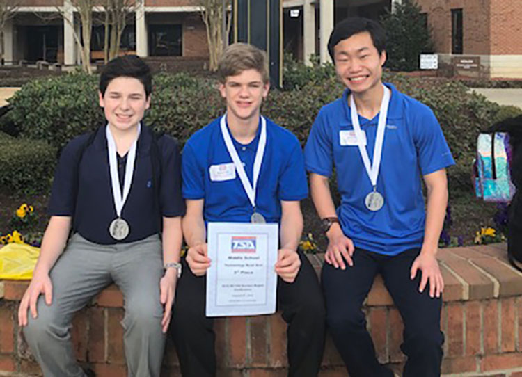 The Tech Bowl team from Contentnea-Savannah K-8 School – from left, Jared Carlyle, Matthew Hill and Jackson Heath – took third place at the NCTSA Eastern Conference regional competition Friday. Photo by Patrick Holmes / Lenoir County Public Schools