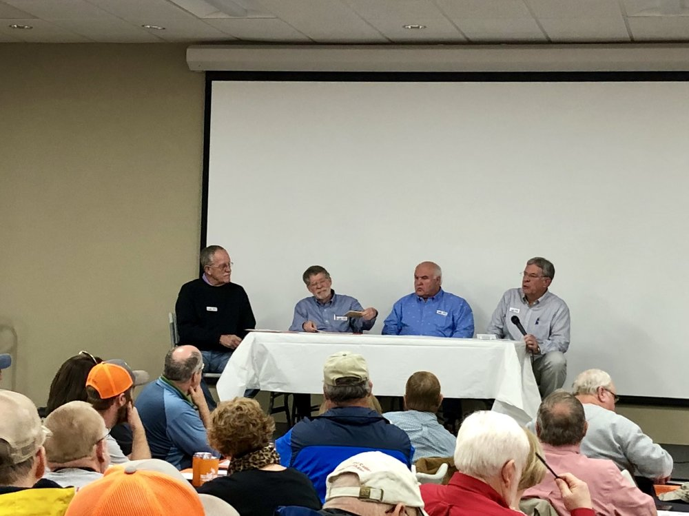 From left, experienced cook-off judges Charlie Martin, Lubin Prevatt, Keith Fuller and Brownie Futrell talk about what they are looking for when they judge. Photo by Catherine Hardee / Neuse News