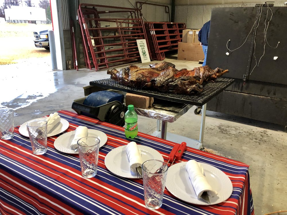 This pig, cooked by the 'Late Night Porkin' team out of Clayton waits for the judges' attention. The team, led by Philip Weeks with assistance from Jeremy Eckhart, uses all natural fuels to cook. Photo by Catherine Hardee / Neuse News