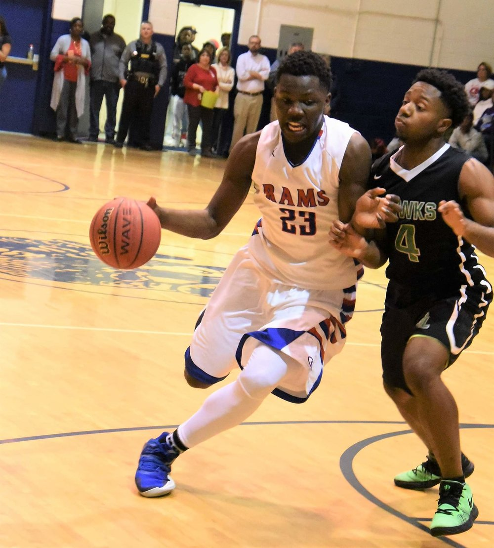 Greene Central's Imajae Dodd drives on North Lenoir's Terrance Copper on Feb. 1. Both teams reached the postseason as the Rams will be a No. 2 seed and the Hawks picked up the No. 22 seed. Photo by William 'Bud' Hardy / Neuse News