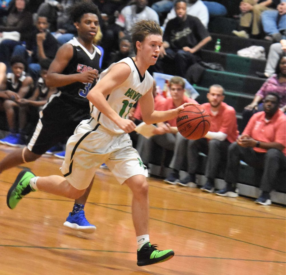 West Craven's Latrell Campbell is in pursuit of North Lenoir's Trevor Sears in a Jan. 25 contest. The Eagles start the postseason on the road as a No. 18 seed. Photo by William 'Bud' Hardy / Neuse News