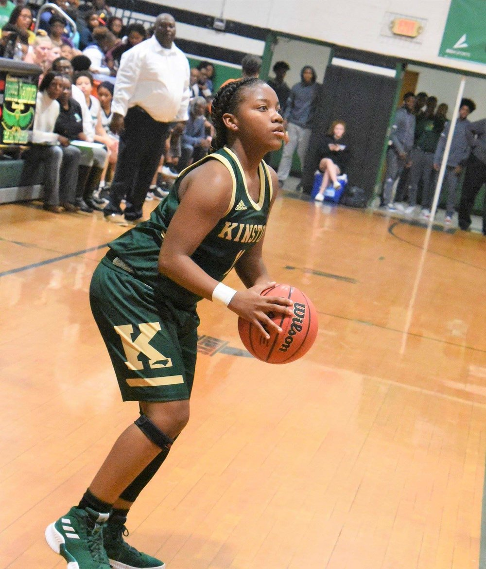 Kinston's Michyla Dove prepares to take a 3-pointer in a game against North Lenoir Jan. 22. The Vikings won the ECC and received a No. 3 seed in the state playoffs. Photo by William 'Bud' Hardy / Neuse News