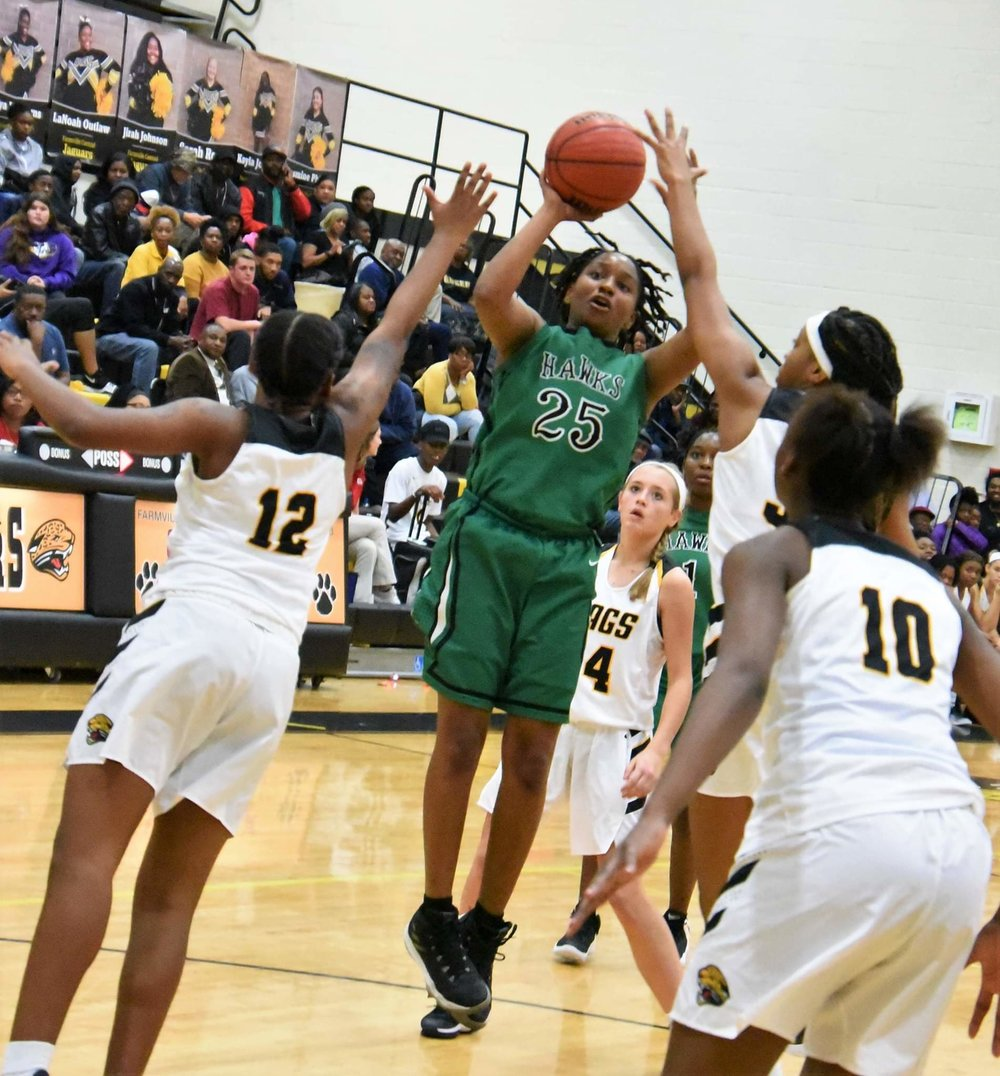 North Lenoir's Ashanti Lynch shoots under heavy duress against Farmville Central on Dec. 5. The Hawks received a No. 13 seed in the state playoffs. Photo by William 'Bud' Hardy / Neuse News