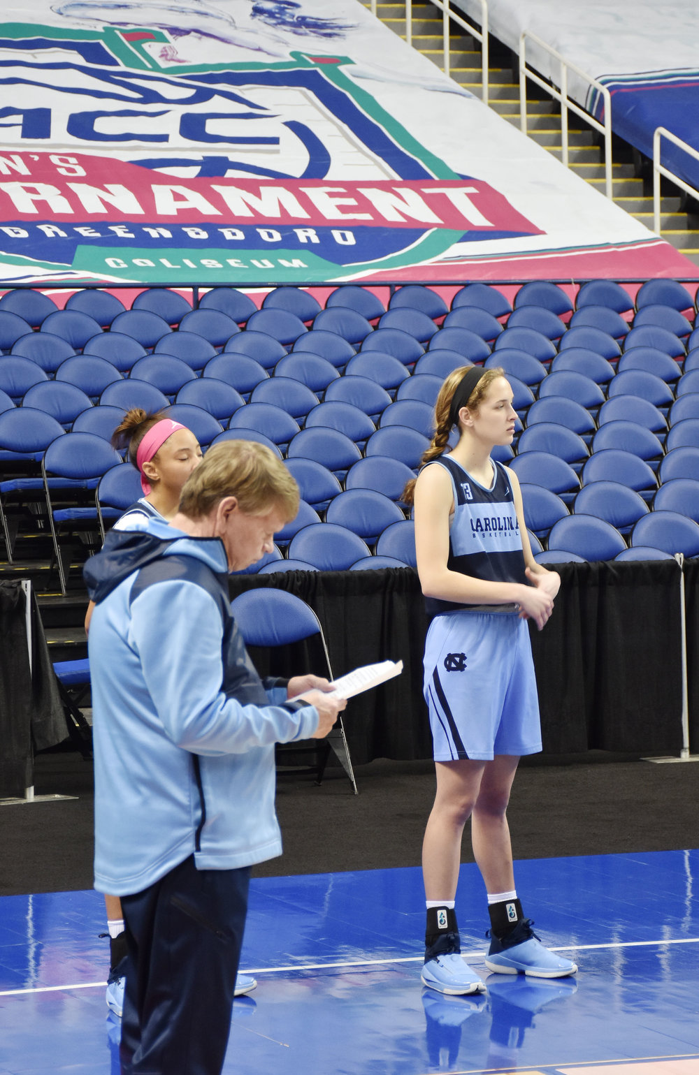 UNC freshman forward Hunter West, right, takes a break during Wednesday morning's practice at the Greensboro Coliseum. Photo by Bryan Hanks / Neuse News