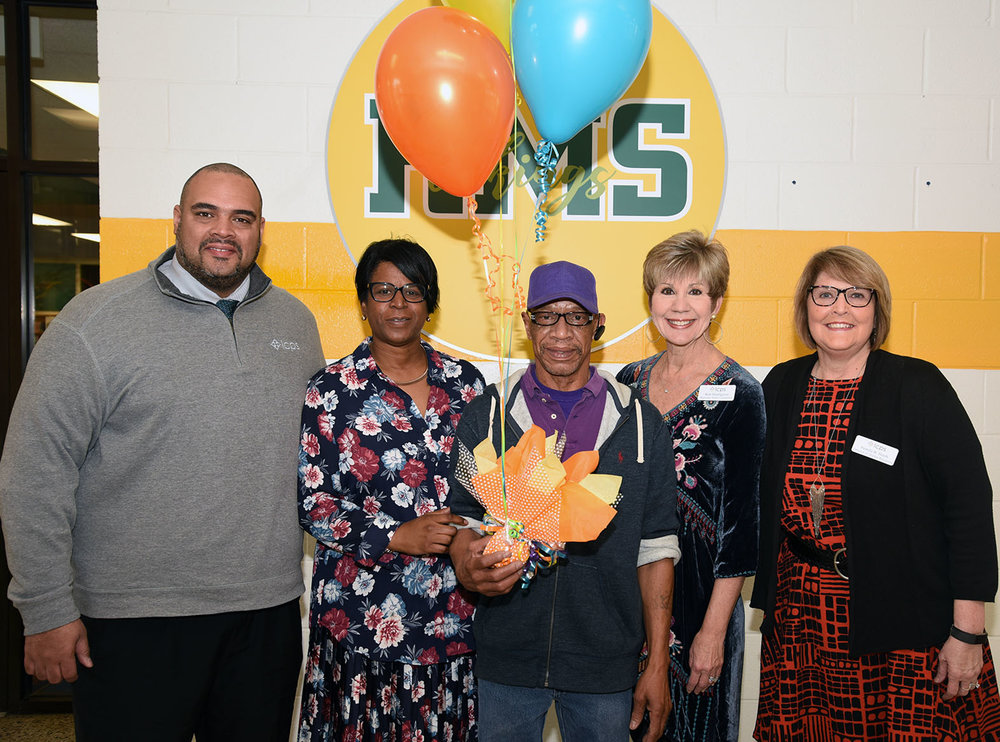 Lenoir County Public Schools Non-Instructional Classified Employee of the Year Kenneth Suggs, center, is honored by, from left, Assistant Superintendent Nicholas Harvey II, Rochelle Middle School principal Felicia Solomon, Beginning Teacher Coordinator Kim Hazelgrove and HR Director Pam Heath. Photo courtesy LCPS