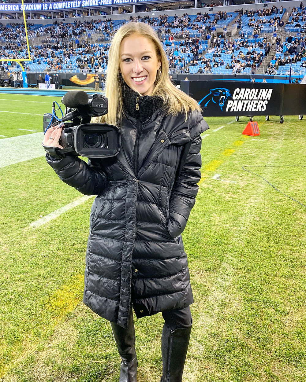 Ariel Epstein poses for a photo before a Carolina Panthers game.