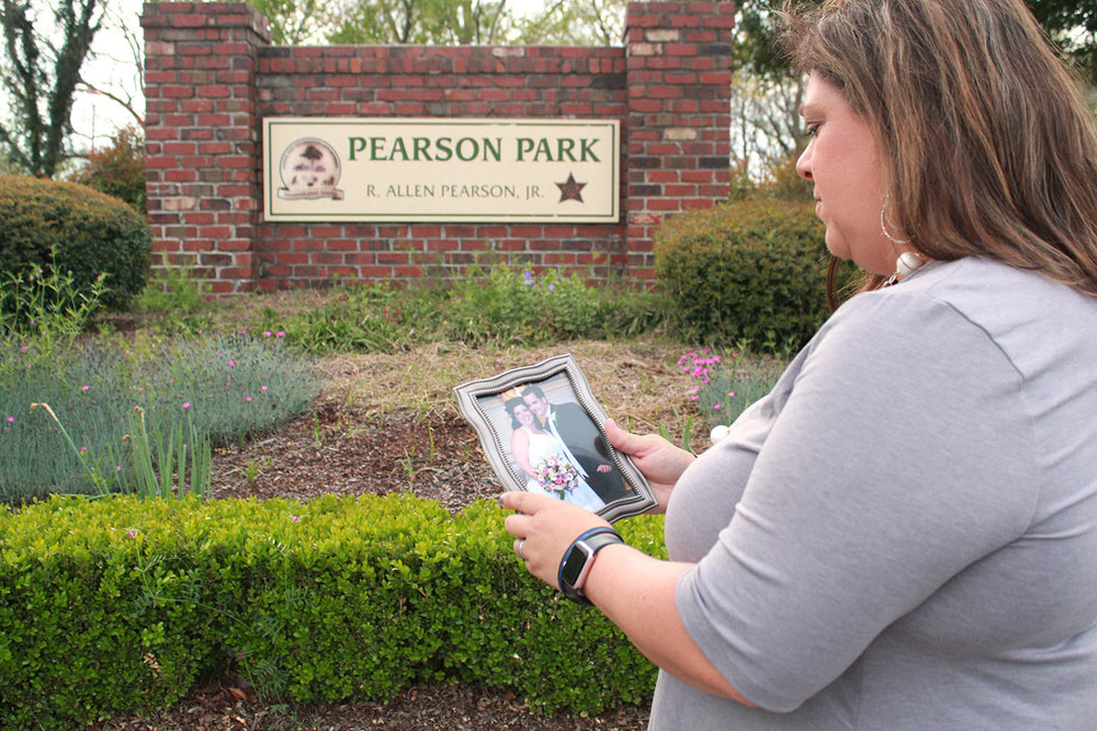 Katherine Pearson looks at the wedding photo of her and Allen at Pearson Park on Sunday. Photo by Linda Whittington / Neuse News