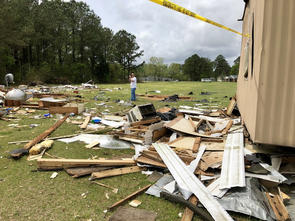 A fire official photographs the debris from the house explosion. Photo by Catherine Hardee / Neuse News