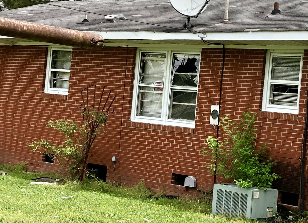 A home across the street from the explosion had multiple broken windows. Officials said at least four houses were damaged by the explosion. Photo by Catherine Hardee / Neuse News