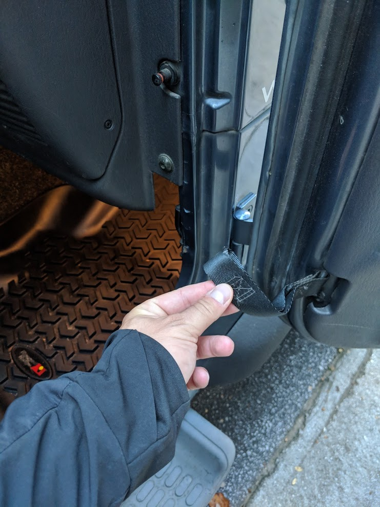 The door strap is very easy to remove from your Jeep Wrangler TJ.